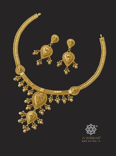 Double Diya Necklace:   Two types of chains, two styles of craftsmanship, two kinds of ball jhur, a two storeyed center-piece and a name that's an obvious double entendre. Undoubtedly a pure gold gift for someone you love so much that you'd give everything twice over.