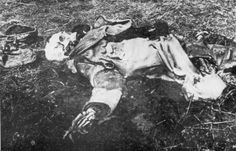 """Dead French soldier near Ypres, 1915. Because of bombardment other soldiers could not recover the corpse until one year after death. He was seen all the time from the trenches, so the Germans gave him the nickname """"Der Leichengigerl von Flandern""""  [""""The dead dandy of Flandres"""".]"""