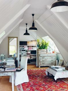 converted attic workspace?  love the lighting and use of old furniture instead of brand new.