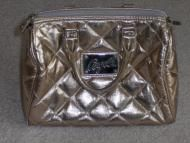 Price $14.97 Metallic speedy design bag that has black lining on the inside. Zipper closure over top of bag to secure. Nice square plate on front of b...