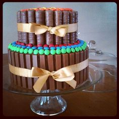 Regular chocolate frosted cake with M's,Twix and Kit Kat Bars