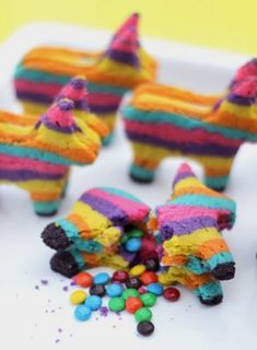Mini cookie pinata! Fill insides with m&m's and other small candies. Cute dessert idea for a party.