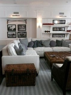 Gorgeous vintage sports theme family room with white wainscoting wall paneling and built-in open shelves with corbels and wall sconces. Le Living, Home And Living, Living Spaces, Living Rooms, Cozy Living, Cottage Living, Wainscoting Wall Paneling, Wood Paneling, Cozy Basement