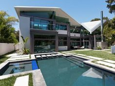 Actor Jack Black's Modern Hollywood Pad - Cool Blues - A rear view of the home highlights its interesting peaks and angles, as well as the property's sprawling pool area.