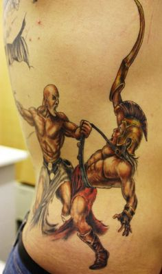 Angel soldier tattoo colored ink soldier angel tattoo tattooshunt tattoo of warrior warriors tattoos designs publicscrutiny Image collections