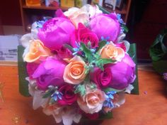 Colorful wedding bridal bouquet including pink peonies...in season during May and June