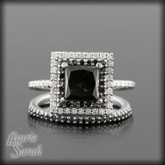 LS831 - Contemporary and stunning, this amazing black and white diamond wedding set is perfect for the modern girl. It sports a princess cut black diamond for its center.  BE INVOLVED! Many dream of the perfect, Handmade Engagement Ring - with Laurie Sarah your dreams will become reality! Copy and paste this link into your browser to see a video about how we make each piece! https://youtu.be/Rvmwzdkgkxk You will be fully involved in choosing your perfect center gem. The listed price for this…