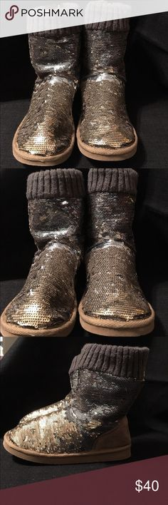 Size 7 Pink Victoria's Secret ugg boots Cute size 7 silver sequined boots by Pink Victoria's Secret, faux fur lined with cute zippers on the back, great condition and gently used. PINK Victoria's Secret Shoes Winter & Rain Boots