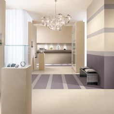 Cream Ultra Thin & Large 1200x600mm porcelain wall and floor tiles installed in a modern retail outlet