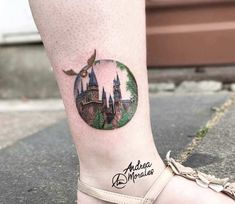 Hogwarts and golden snitch tattoo by Andrea Morales - Awesome 3 colors realistic tattoo artwork of Hogwarts and golden snitch motive from Harry Potter mo - Hp Tattoo, World Tattoo, Piercing Tattoo, Tattoo You, Body Art Tattoos, Cool Tattoos, Piercings, Hedwig Tattoo, Movie Tattoos