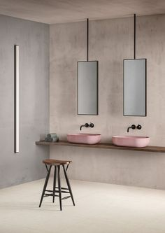 Minimal and contemporary bathroom design and styling concept by Elisabetta Bongiorni featuring two of our Rho concrete basins in blush.