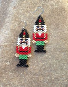 Nutcracker Beaded Earrings Presents: Christmas is coming Christmas or the Christ event, the Festival of lights, the Food of peace, or the Christmas. Hama Beads Patterns, Beaded Jewelry Patterns, Beading Patterns, Bracelet Patterns, Seed Bead Earrings, Etsy Earrings, Beaded Earrings, Seed Beads, Beaded Christmas Ornaments