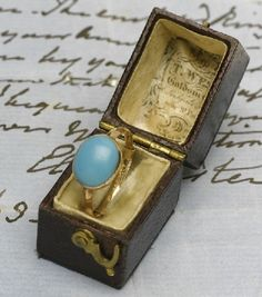 Jane Austen's Ring The ring is simple and elegant. The stone is believed to be odontalite, a popular 19th c substitute for turquoise, and the setting is gold. The ring is still in an early 19th c jeweler's box that may be the original.