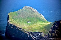 This enchanting house is located on an island called Ellidaey near Vestmannaeyjar, a small archipelago off the south coast of Iceland. The island is uninhabited, but has a large hunting lodge, constructed in 1953.