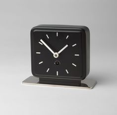 Table Clock Marianne Brandt (German, 1893–1983)  c. 1930. Painted and chrome-plated metal, 5 3/4 x 6 7/8 x 2 3/4 (14.6 x 17.5 x 7 cm). Manufactured by Ruppelwerk GmbH, Gotha, Germany. Gift of Jo Carole and Ronald S. Lauder