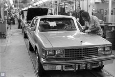 """Cadillac's PR photographer took this photo of a Seville and the activity in the """"Drive-Off"""" area near the end of the line at Clark Street Assembly in the Spring of 1976 Assembly Line, Cadillac Fleetwood, Cadillac Eldorado, Home Team, Station Wagon, Seville, Car Photos, Vintage Cars, Cool Cars"""