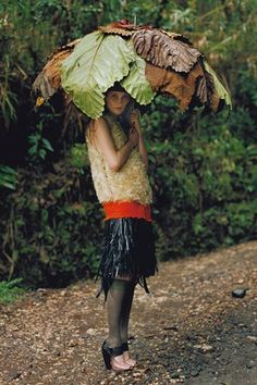 'To The Ends Of The Earth' by Tim Walker VOGUE UK 2007 I love the concept of leaves incorporated as an umbrella...beautiful as a stage background in some way