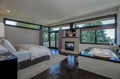 Modern Master Bedroom - Found on Zillow Digs// Love this bedroom with it's gorgeous flooring, fireplace, jacuzzi bath tub...Prob would need NO other room in the house!