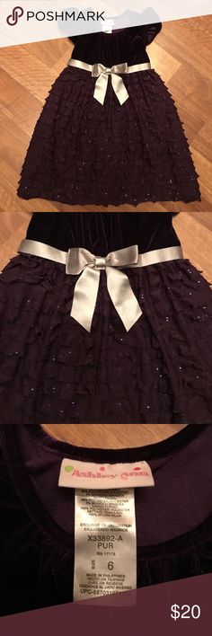 💙 Dark Purple Girl's Formal Dress This classy dress is an elegant deep purple and pictures don't do it justice. Velvet upper, silver waist bow and layered, sequined bottom. Excellent condition! All of my items come from my smoke-free home. I ship my orders out fast. Bundle and save!!! 💜📦💜 Ashley Ann Dresses Formal