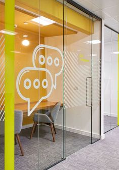 This meeting space is ideal for two colleagues to have a chat or do focused work on a project together. Colourful icons and graphic detailing are used on the glass meeting room exteriors to provide a bold, modern look to the fit out. || Creative office | Meeting Space || #CreativeMeetingSpace www.ironageoffice.com