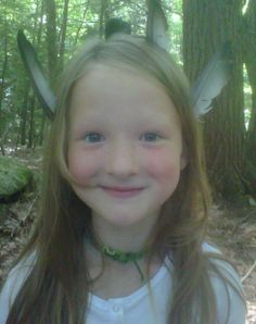 Alaina found a pile of feathers in the forest and put them in her hair. My little wood elf.