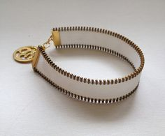 $22  3/4 wide zipper bracelet with Om charm. Available by MiColeccion