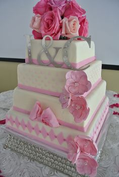 This is so me!  if i could pick a cake this would be it!!! Pink Square Wedding Cakes