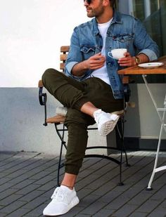 army green pants a white tee a denim jacket and white sneakers