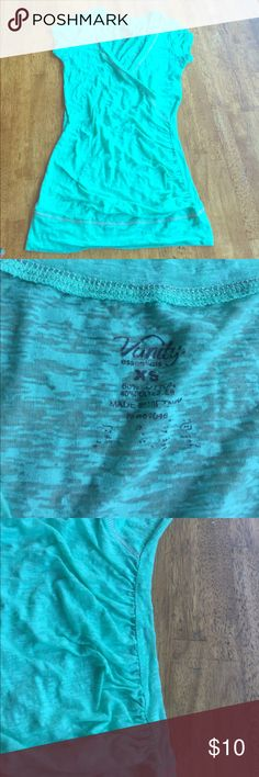 Light teal shirt Very stylish shirt. Has a crossover look at the v.. Vanity Tops