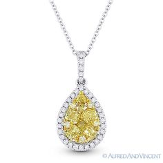 The featured pendant is cast in 18k gold and showcases a white gold loop and tear-drop design set with white diamonds in pave settings. The circle design is then topped at the center with a yellow gold piece encrusted with cushion & round cut yellow diamonds.  #diamonds #18kjewelry #18kgold #whitegold #tear-drop #pendant #necklace