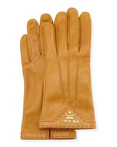 Prada napa leather gloves. Gauge points. Pickstitch trim. Golden logo detail. Made in Italy.