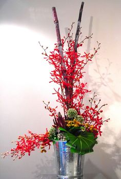 tropical flowers with amazing firecracker orchids - nice arrangement for any table