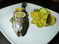 Trout, filled with lemon and herbs, served with German potato salad