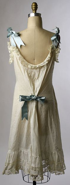 (2/2) Chemise Date: ca. 1900 Culture: American Medium: cotton.  I love shoulder bows!