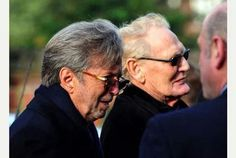 Ginger Baker, center, with Eric Clapton at the funeral of Cream bandmate Jack Bruce. The hard-living Mr. Baker is still kicking at age 75. Some things just can't be explained.
