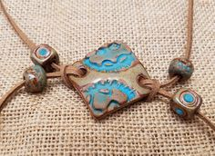 Ceramic bracelet topper and beads. Handmade, one of a kind, ceramic, stoneware, rustic, equestrian beads, ceramic pendants, jewelry supply.