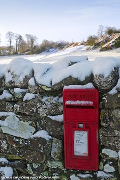 Post box in the snow beside the golf course at Casterton, Cumbria