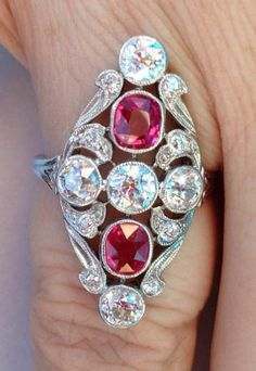 Vintage Ruby and Old European Cut Diamond Ring: beautiful old European cut diamonds, vivid red rubies, and lovely details--all swoops and curves. Read more: http://www.pricescope.com/blog/jewel-week-vintage-ruby-and-diamond-ring#ixzz2IUKQVeer