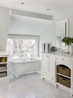 white luxury bathroom decor - I love the baskets under the cabinet.