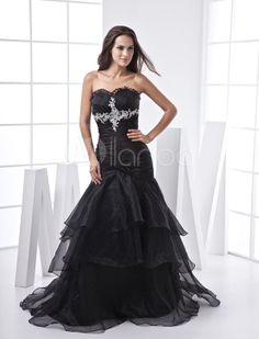 A fantastic dress can let you be the only shining star on the party! This black satin and organza mermaid prom dress is your best choice. It has great designs in all details. This black is an exquisite example of classy sophistication with a touch of flirty fun. It represents elegant and mystery. A black mermaid prom dress with multiple-ruffles skirt and embroidery front, which is irresistible charming and seductive. This fashion prom dress is perfect for your dating time. It is with high…