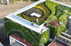 The ultimate green building covered from bottom to top with green surfaces and gardens