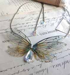 """whimsy-cat: """"Faerie wing jewelry by Under the Ivy. """""""