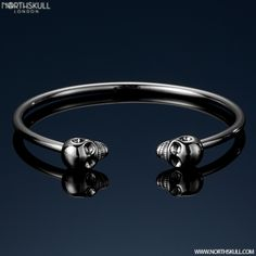 Our Silver Twin Skull Bangle Is The Perfect Compliment To The Wrist, Perfect For Both Formal And Casual Styles The Silver Tones Combined With Our Uniquely Designed Skulls Make This A Staple Piece From Our Selection | Available Now At Northskull.com [Worldwide Shipping] #northskull #Jewelry #bracelet #bangle #silver #luxury