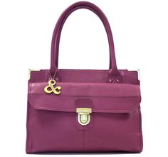 Charlie Pink Leather Tote Bag £165.00 http://www.ollieandnic.com/handbags/leather-bags/charlie-leather-tote-pink  A gorgeous pink leather Tote bag with a generously sized main compartment. There is a large outer pocket on the front of the bag fastened with a tuck lock and decorated with stitch and seam details. Ideal size for and iPad or small netbook computer. Gorgeous floral lining and a matching dustbag to keep it protected when out of use. Available in pink and tan.