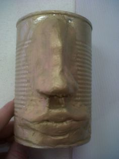 Air dry clay and a tin,  paint bronze or gold,  makes a sculpture