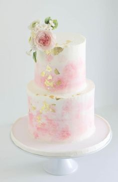 Lovely two tier white wedding cake with pink blush detail and gold flakes; Featured Cake: Cake by Annie