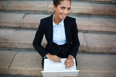 Woman working with laptop outdoors Free Photo