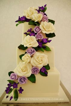 Small three-tiered wedding cake with cascade of sugar roses in lilac, purple and ivory. Argenton, Lake Macquarie. 2012.