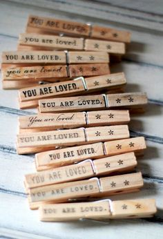 'You are Loved' Clothespin note holder.  A great idea for wedding place cards, seating chart, favors, etc.