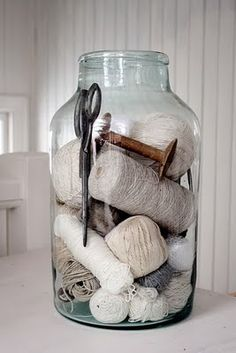 Storage jar full of vintage, tone on tone, threads, yarns, antique scissors, wooden spools etc...love this